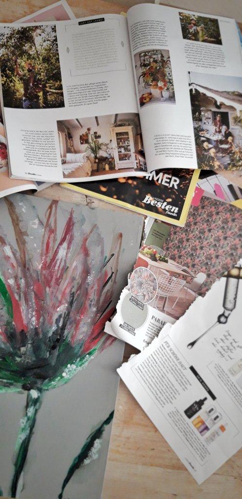 Magazinseiten und ein altes Bild